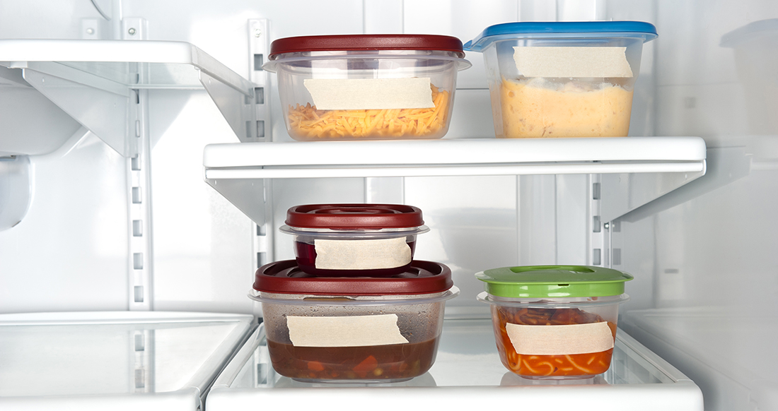 Glass and plastic food storage containers in a refrigerator.