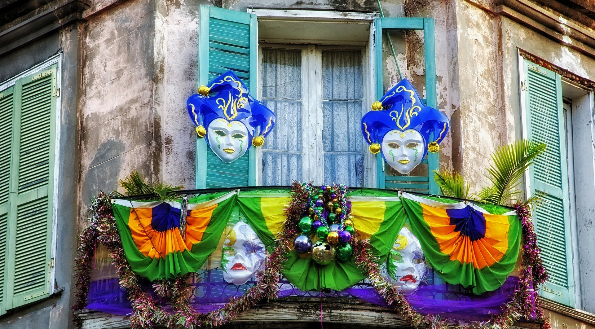 Mardi Gras masks adorn a balcony in New Orleans' French Quarter.
