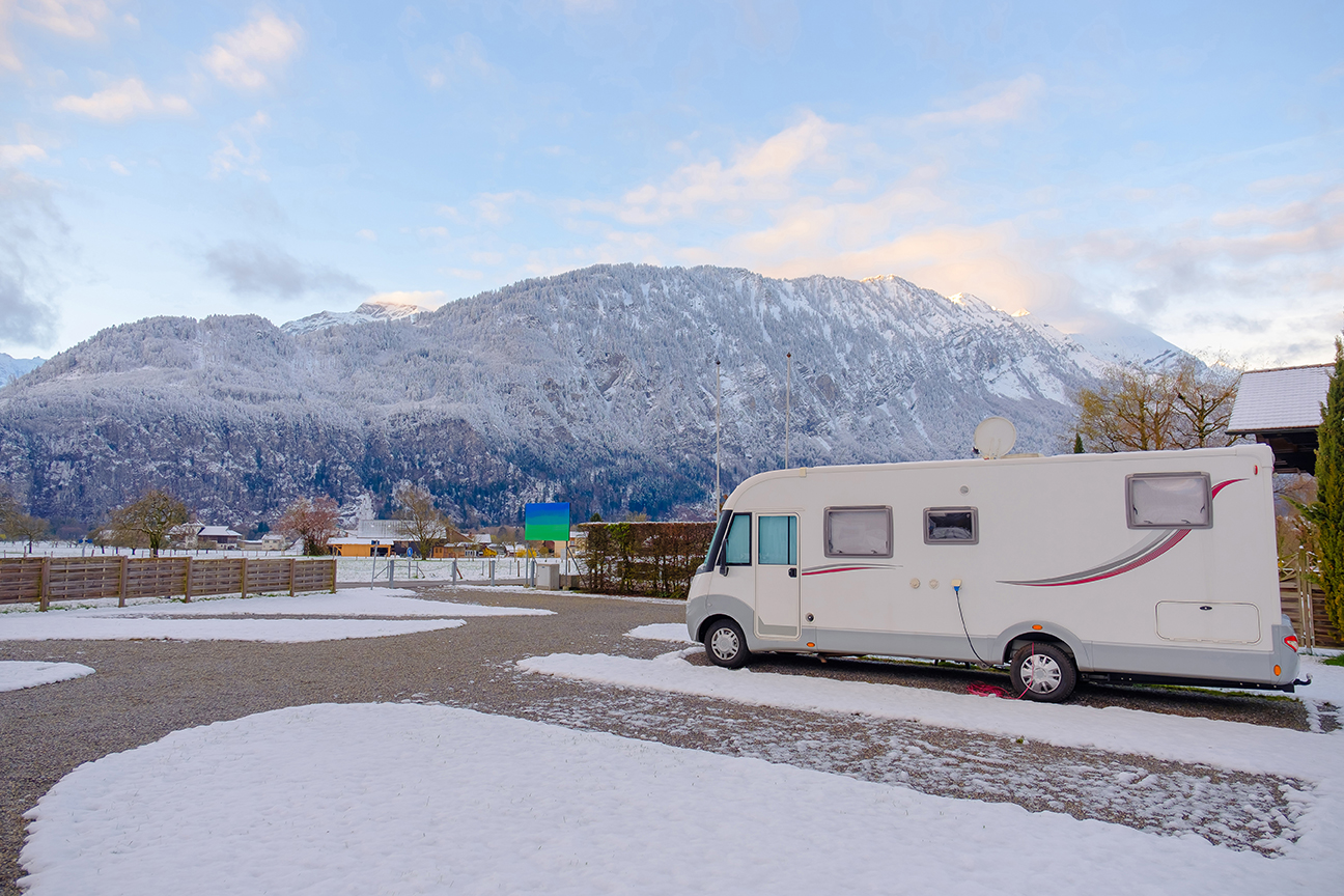 An RV camping in the snow
