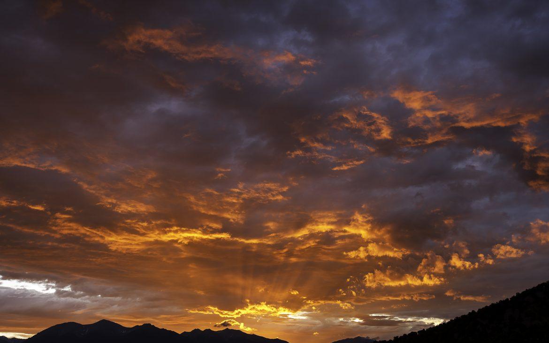 Amazing sunset overlooking dark mountain range