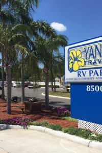 Yankee Traveler RV Park in Florida — a welcoming sign with palm trees