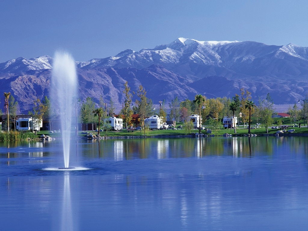 pahrump nevada fall getaway — a row of RVs on a glimmering lakeshore.