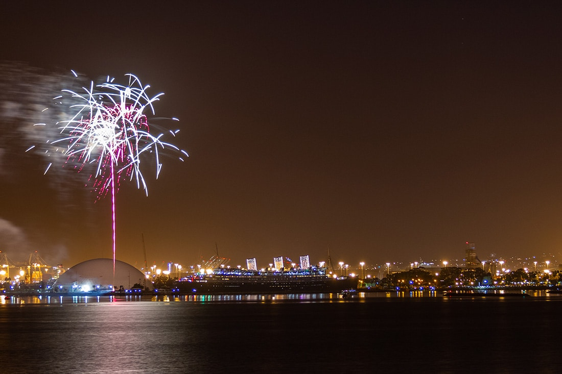 Fireworks explode over the Queen Mary in Long Beach Harbor.