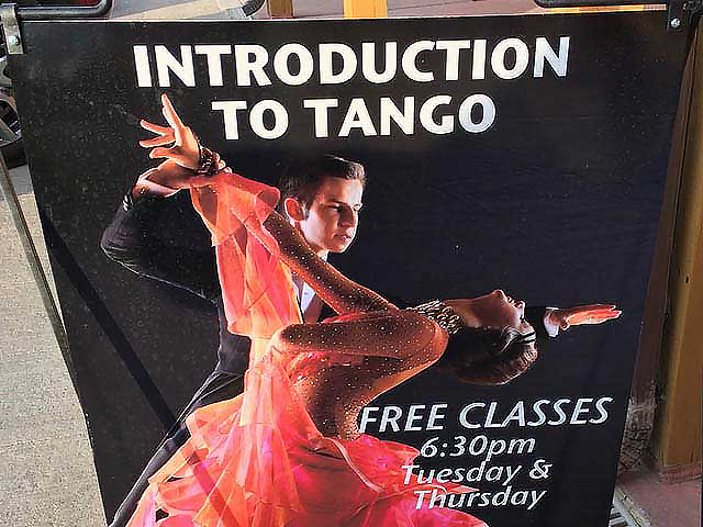 "A poster promoting an ""Introduction to Tango"" class at the resort."