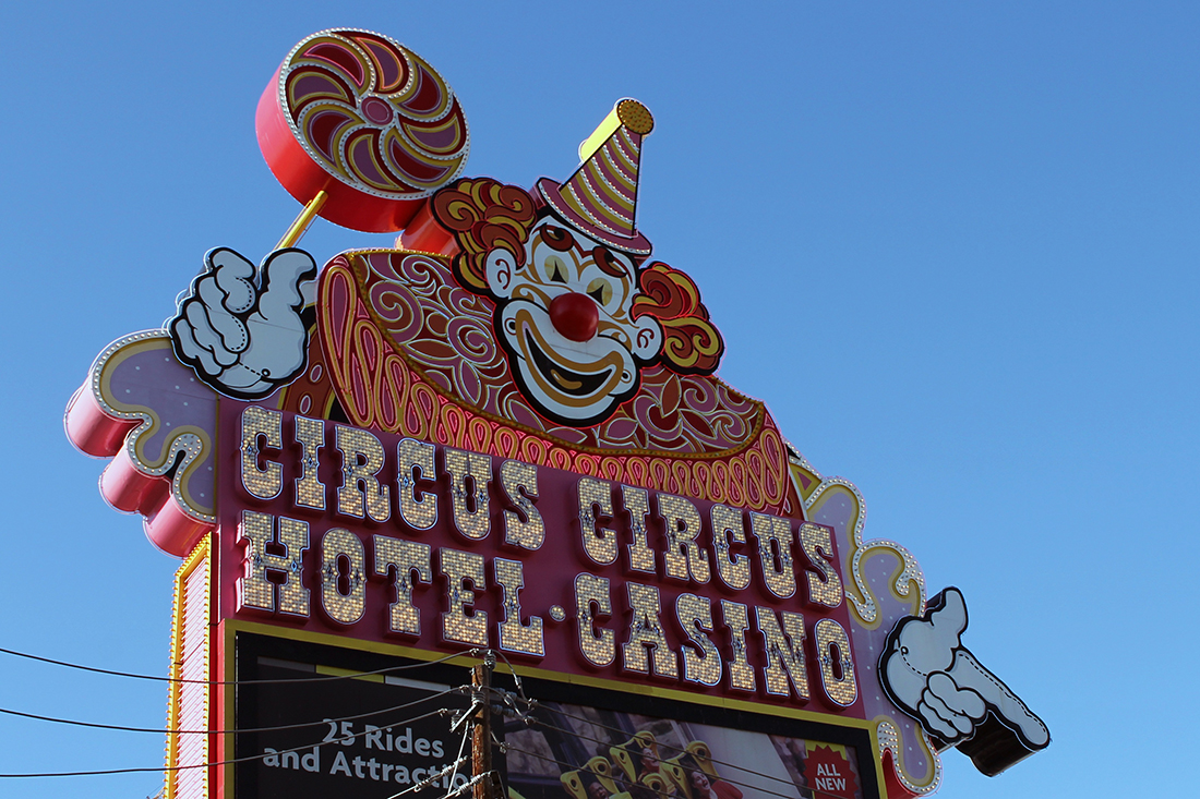 A giant clown holding a sucker is part of the Circus Circus Hotel sign.