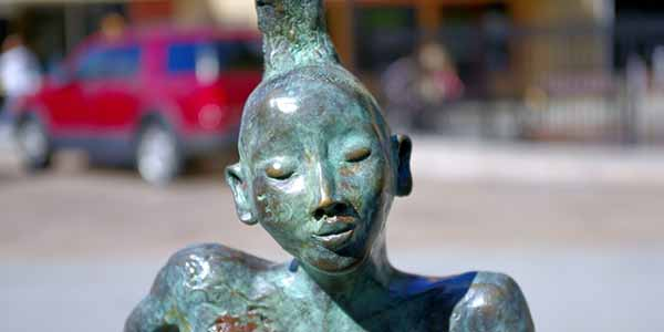 Bronze sculpture of a Native American girl