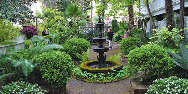 Savannah is home to lush courtyards with wrought-iron fences and elegant fountains.