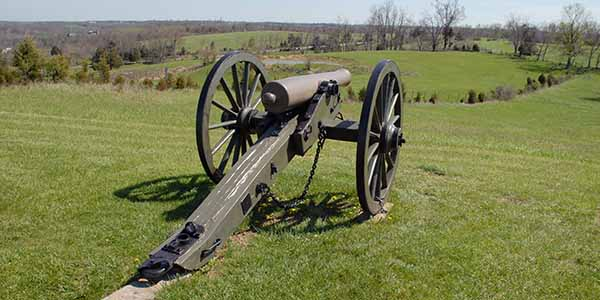 Vintage cannon in a grass field