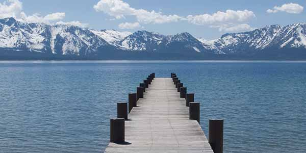 A view of the dock looking towards the snow capped mountains