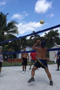 Boardwalk RV Resort — Gateway to the Keys — folks playing vollyball on a sandy court