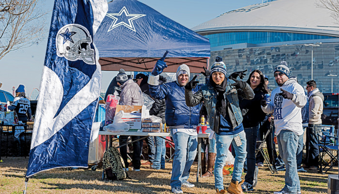 Fans tailgating with Dallas Cowboys memorabilia.