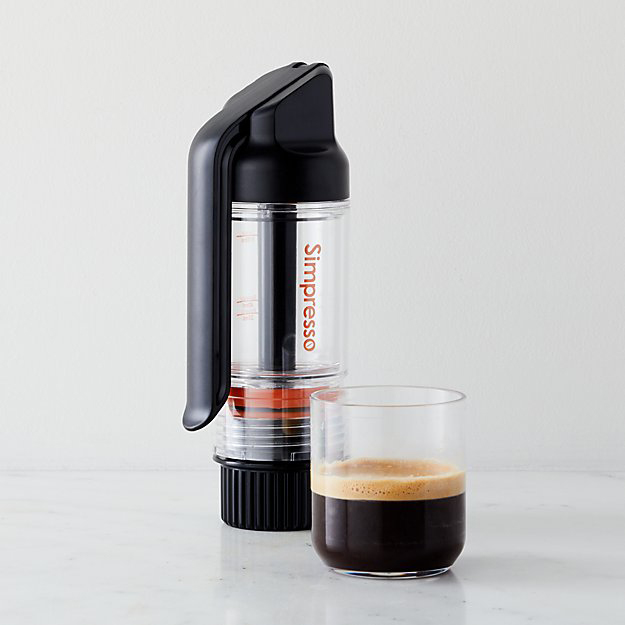 A simpresso portable Espresso maker with cup of foamy espresso