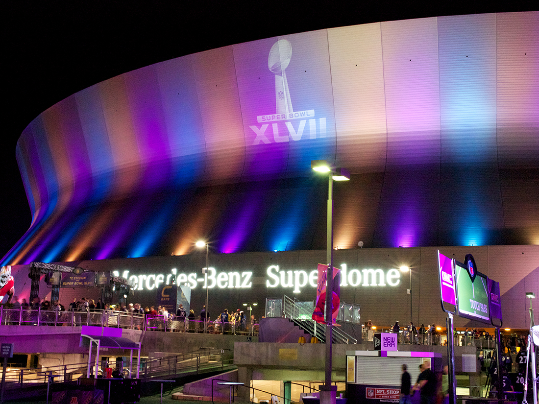 Mercedes-Benz Superdome lit up with rainbow colors.