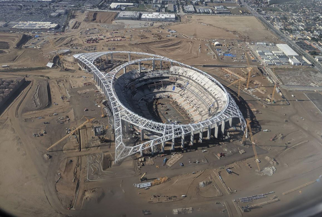 Aerial shot of modernistic stadium under construction.