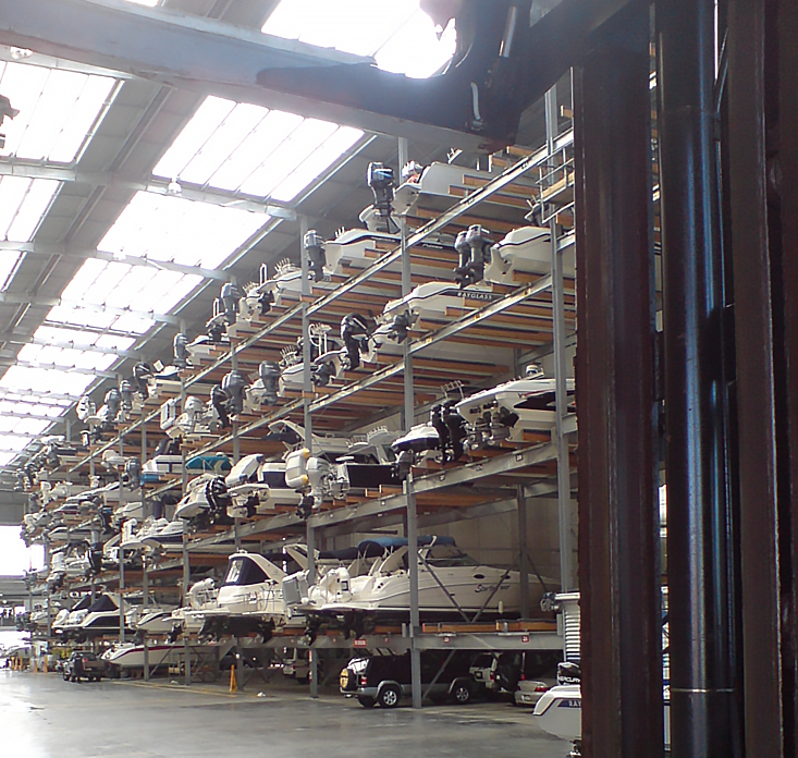 Boats Stacked in indoor storage facility.