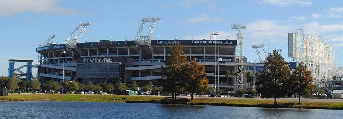 NFL stadium on the banks of a river.