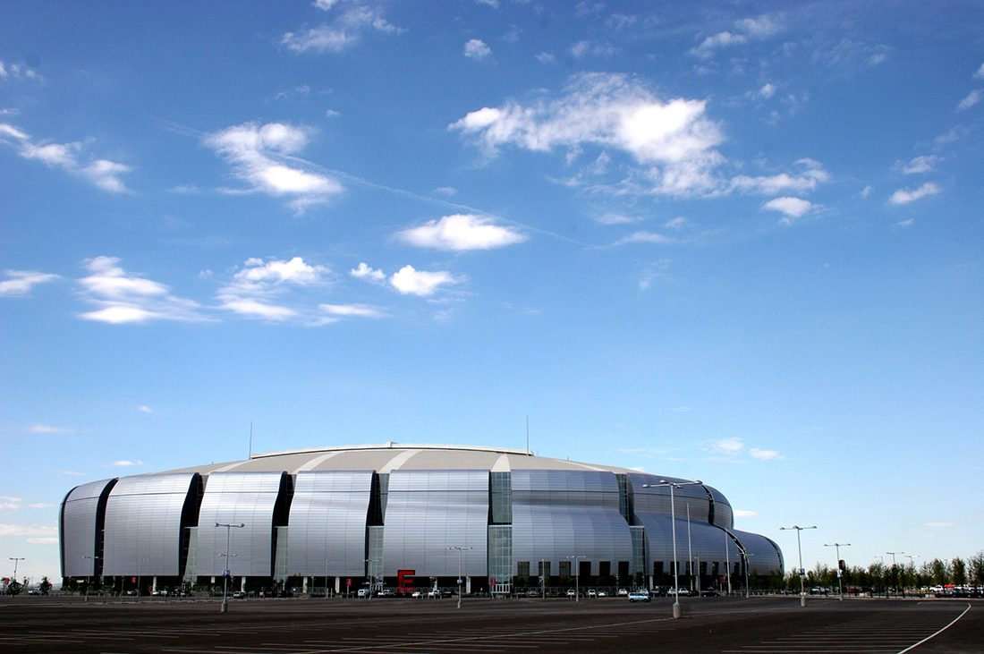NFL RV Tailgating — Football stadium under a clear blue sky.