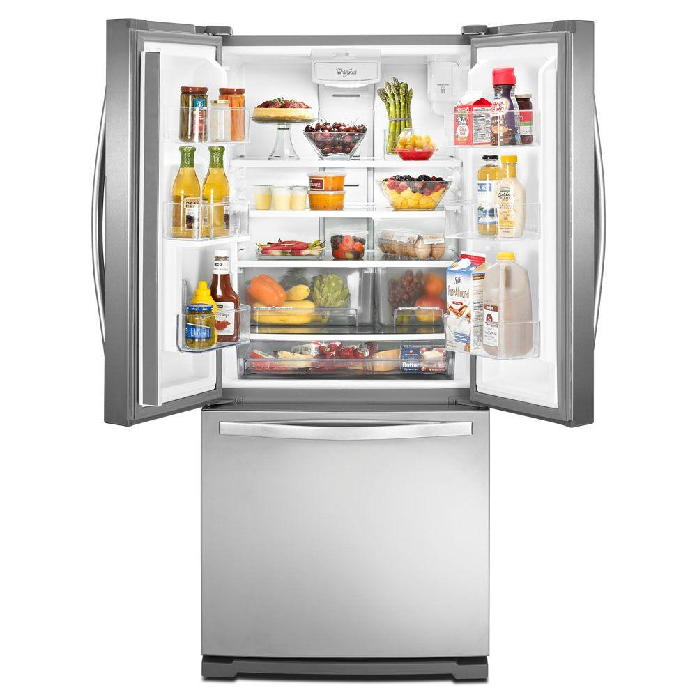 A silver refrigerator with double doors open and freezer on the bottom.