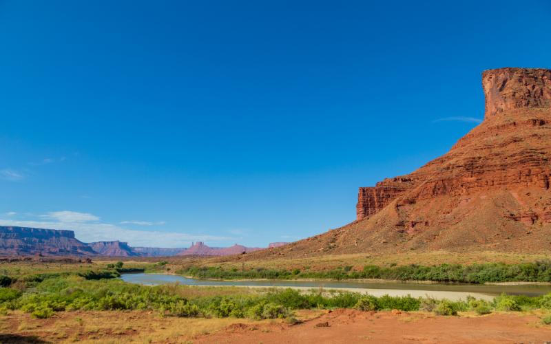A desert butte against a blue sky.