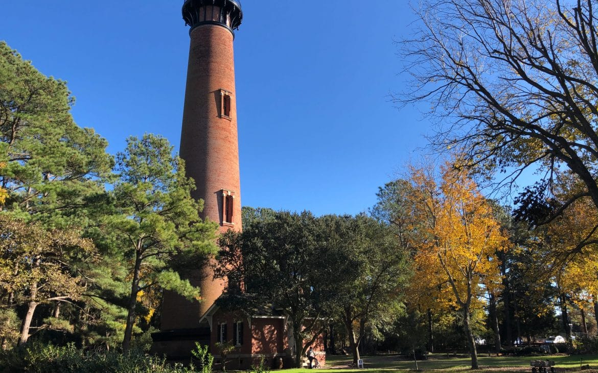 Currituck Lighthouse amid fall colored trees