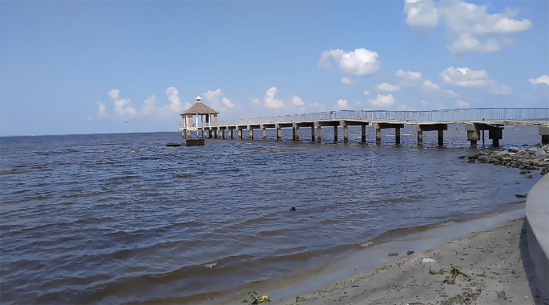 A long concrete pier at Fontainebleu State Park