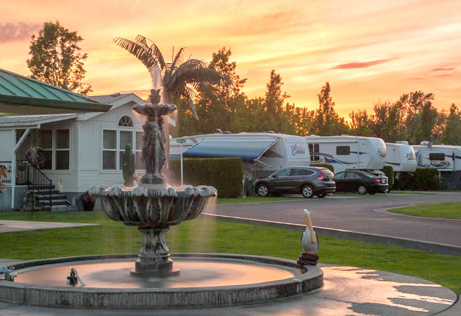 Sunset over parked RVs at Four Seasons RV Resort