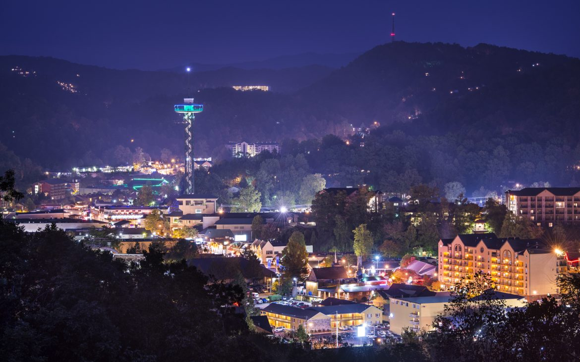 Aerial view of Gatlinburg, Tennessee at night with holiday lights
