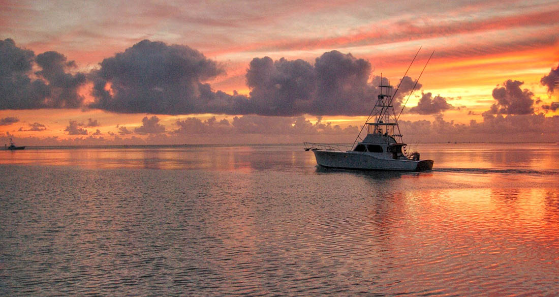 A fishing charter boat leaves very early in the morning from the Florida Keys.