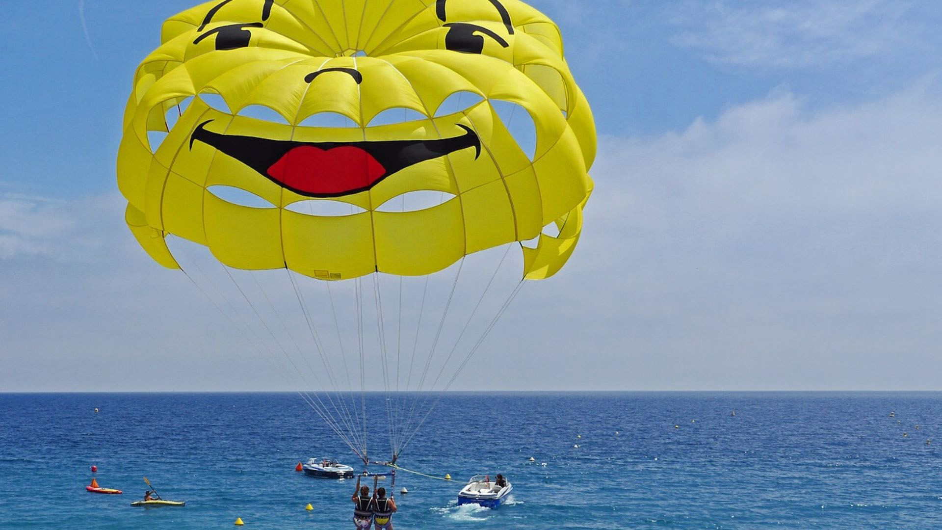 A couple prepares to go aloft for parasailing.