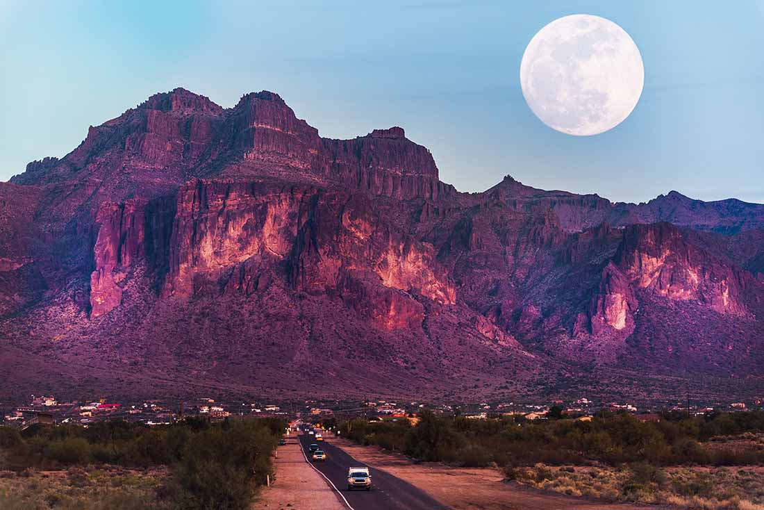 New Good Sam Parks Supermoon rises above rugged Superstition Mountains.