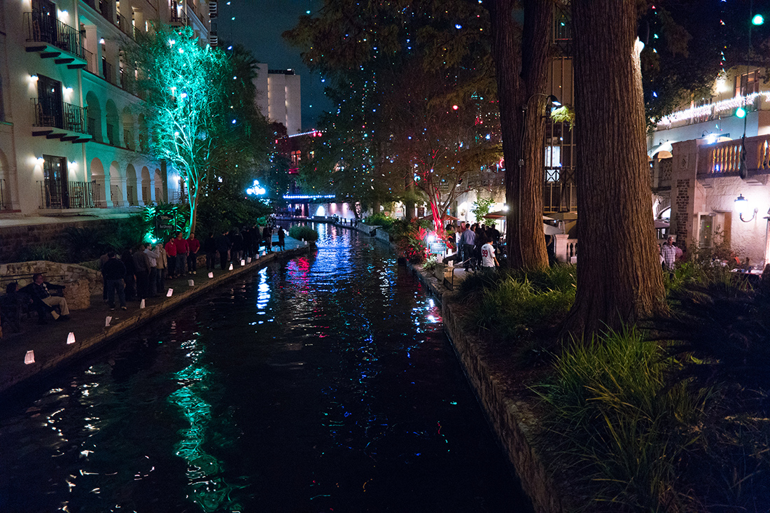 Luminarias and lights twinkle along the banks of the San Antonio River.