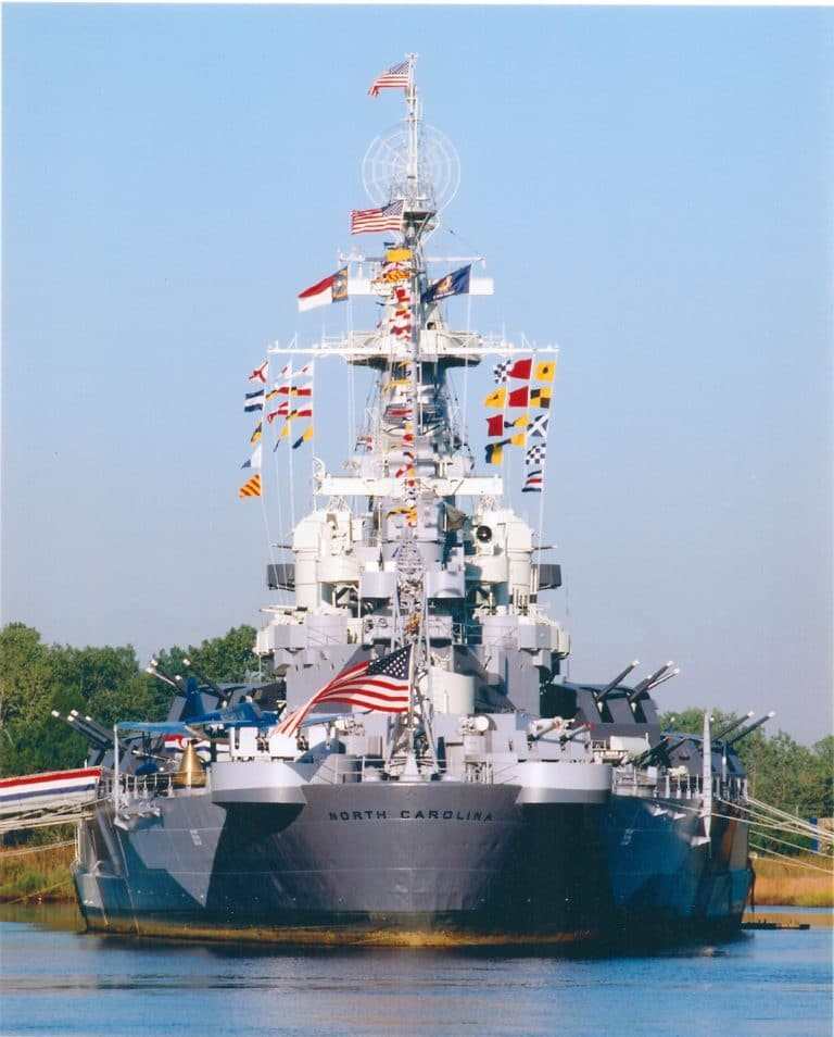 The Battleship North Carolina with colorful flags, stern side.