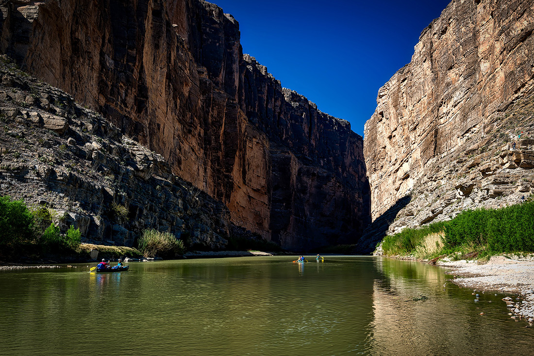 Canoeing through a ravine on the Rio Grande River.