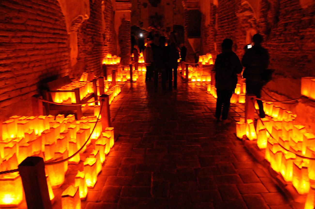 Luminarias line the walls of a Mission breezeway.