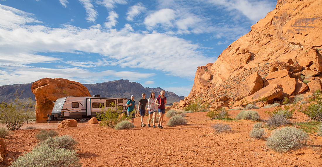 A family of four embarks on a hike in Valley of Fire State Park.