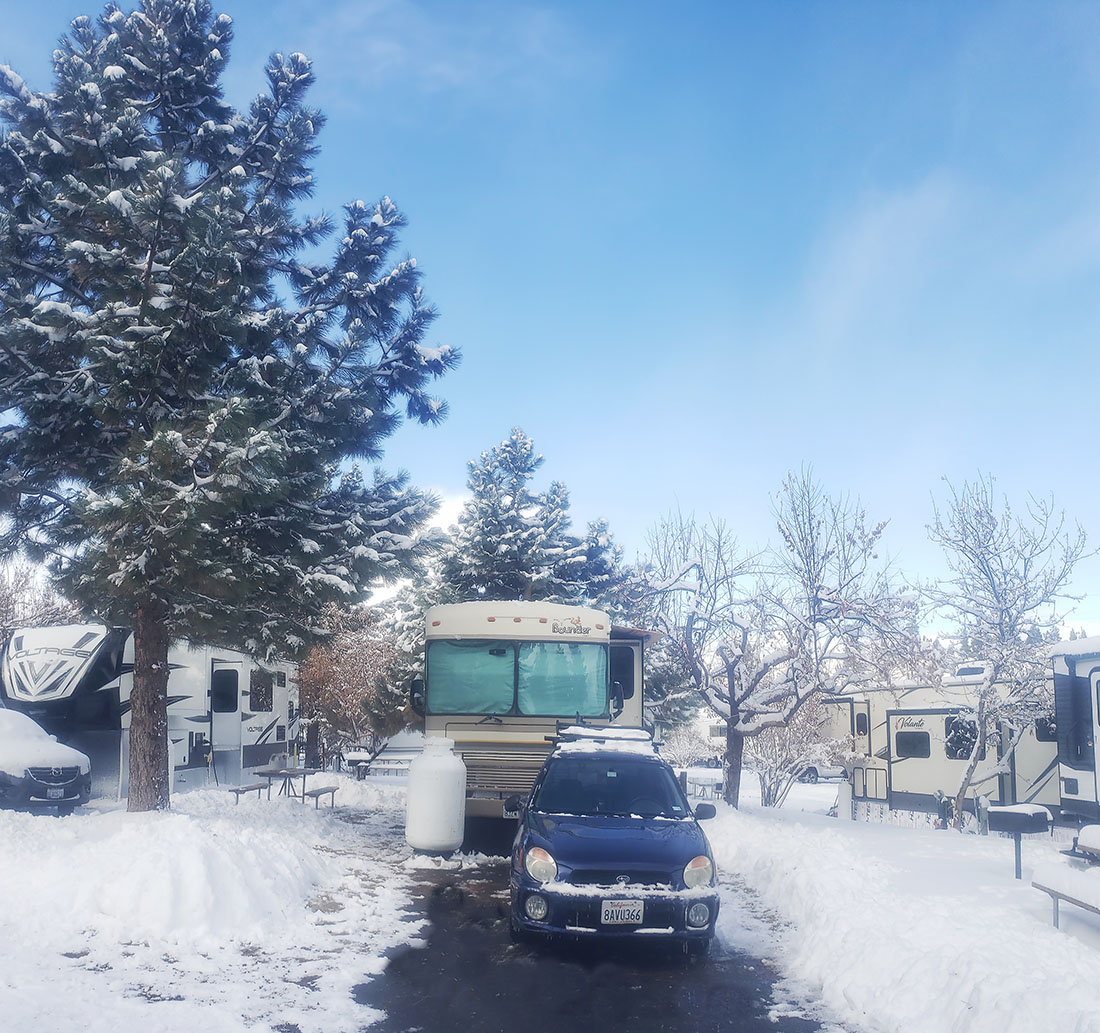 Beautiful winter campsite with car and motorhome