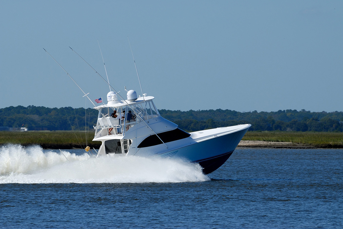 A charter fishing craft speeds across a lake.