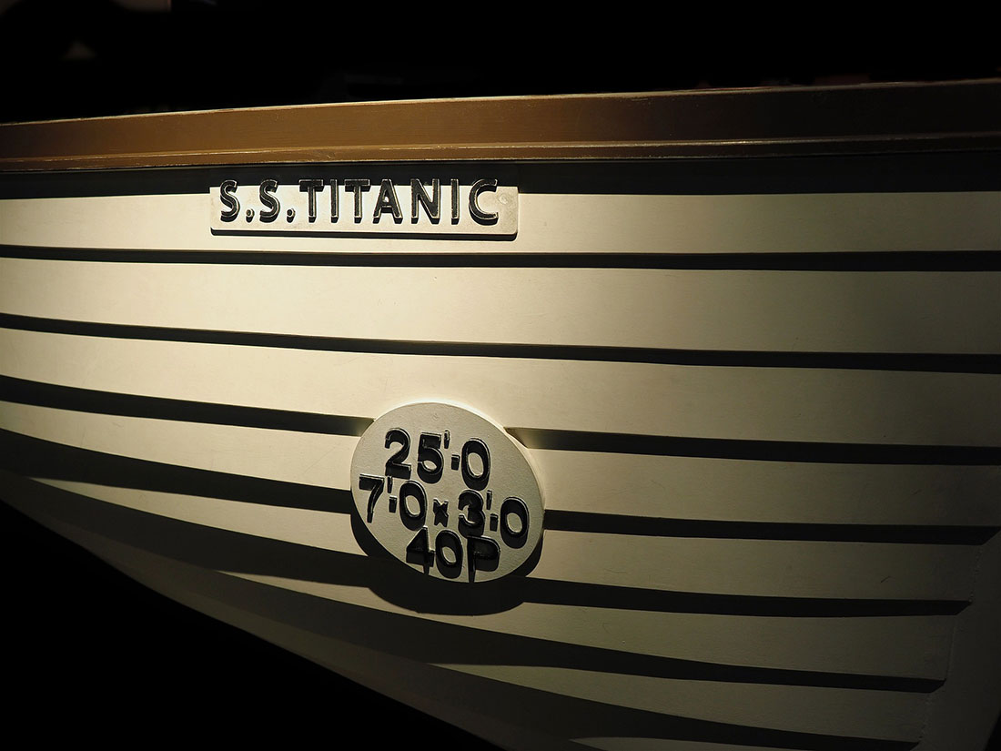 A replica of a titanic lifeboat in low light.<