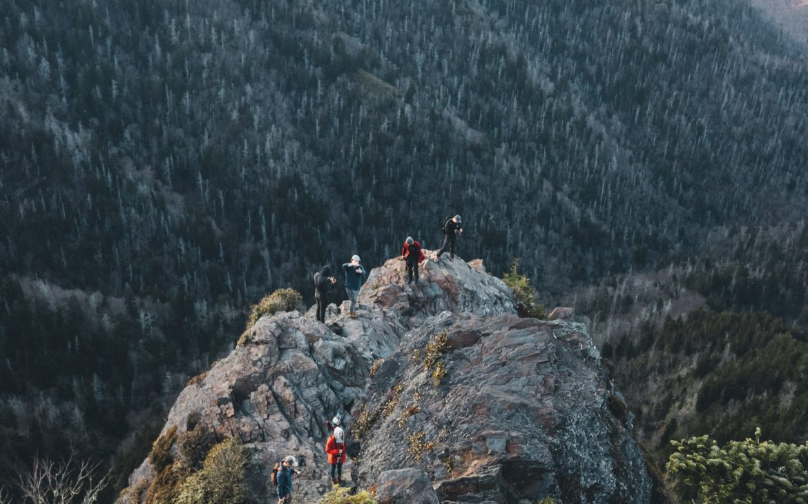 Hikers on top of large rock in Smoky Mountains