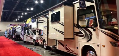 RVs lined in a row at an RV show.