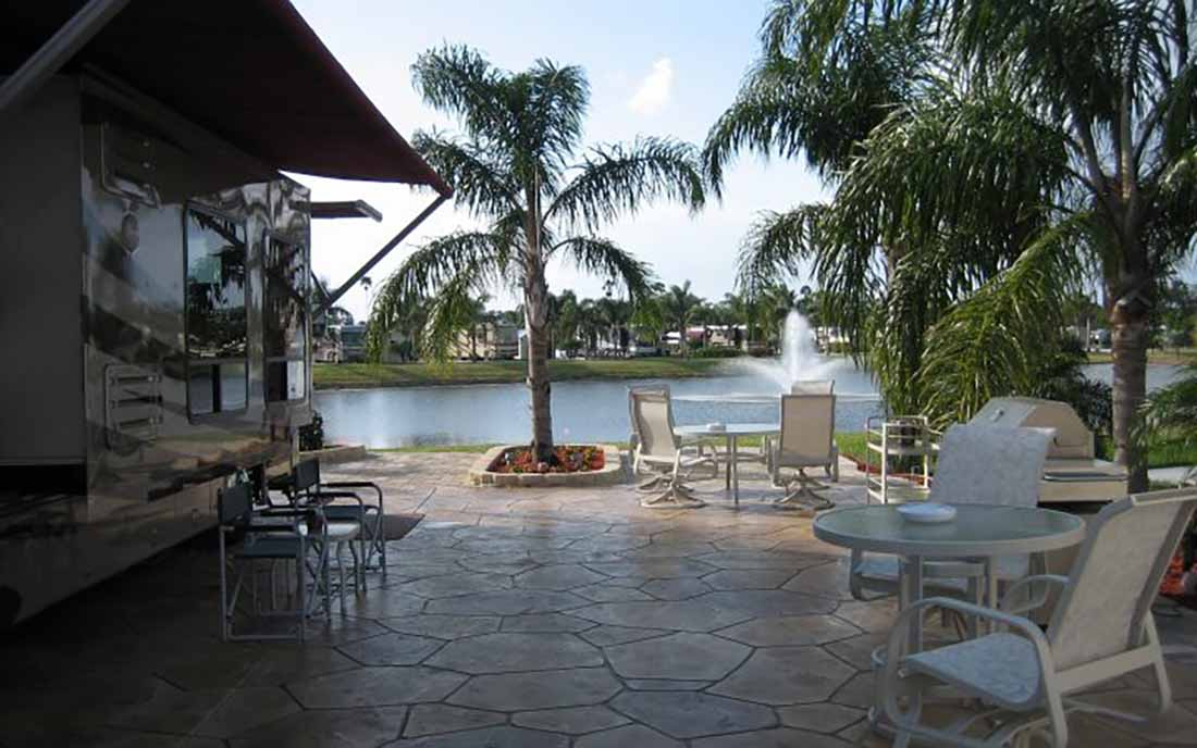An RV lot overlooking a gorgeous pond with fountain.