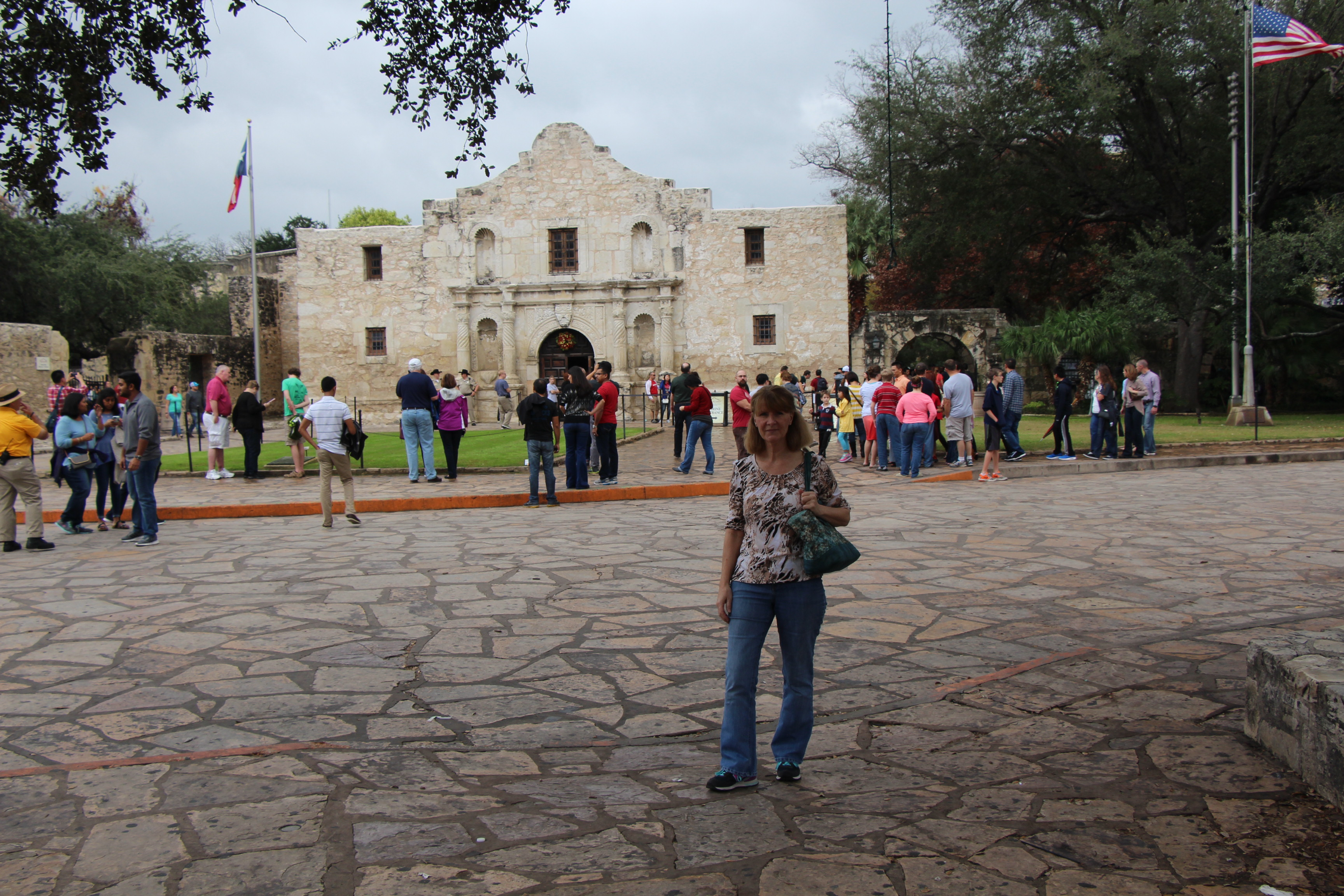 A woman stands near the Alamo in Texas