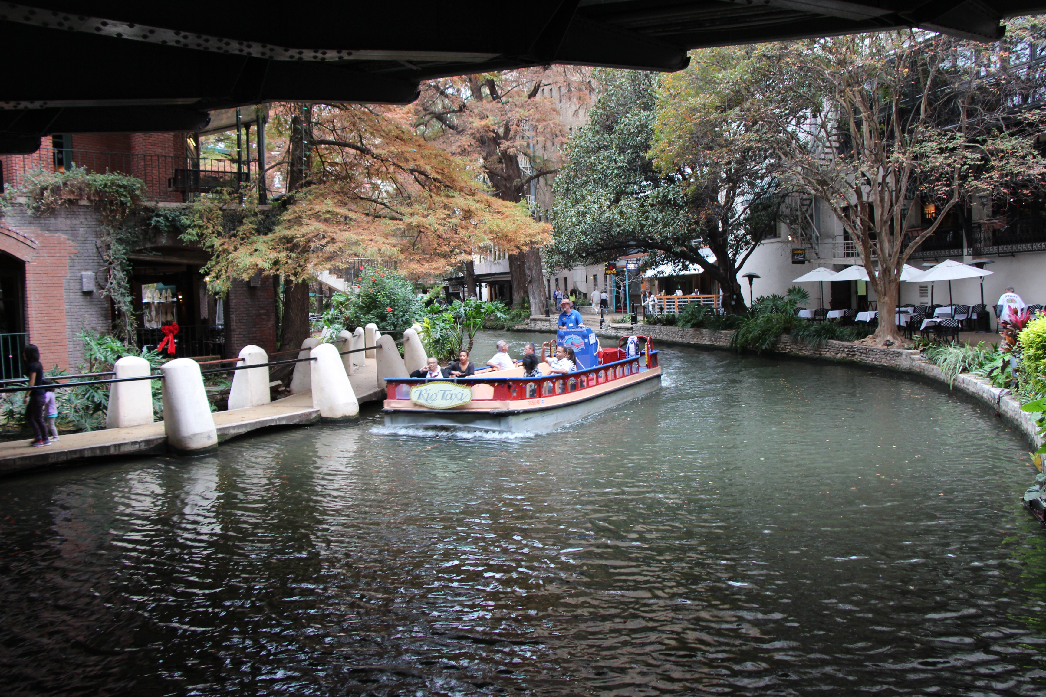 A tour boat on San Antonio's River Walk
