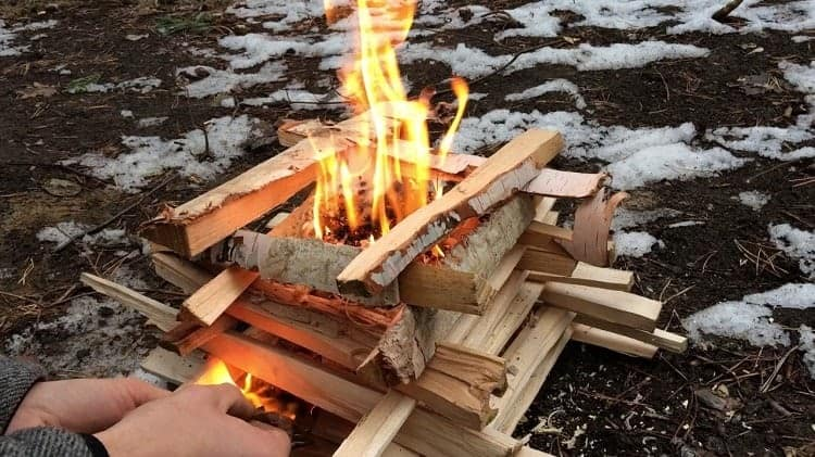 Fire stacked in log cabin formation.