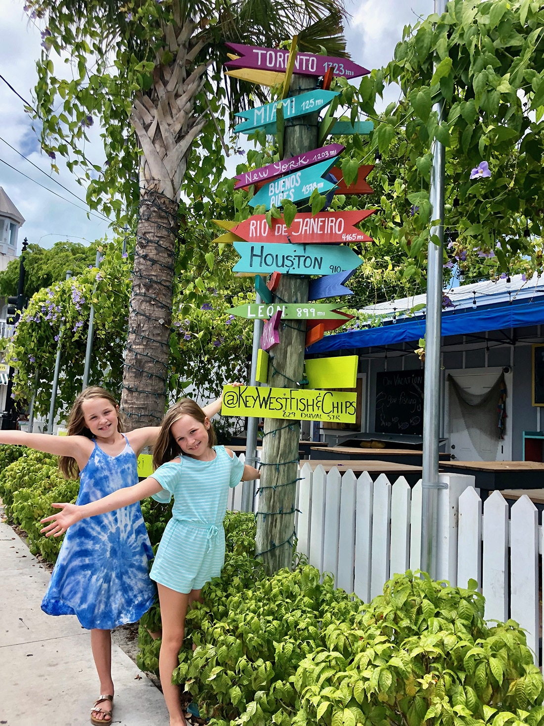 Two girls near a Key West Street Sign