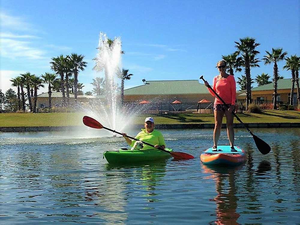 Two park guests on paddleboards