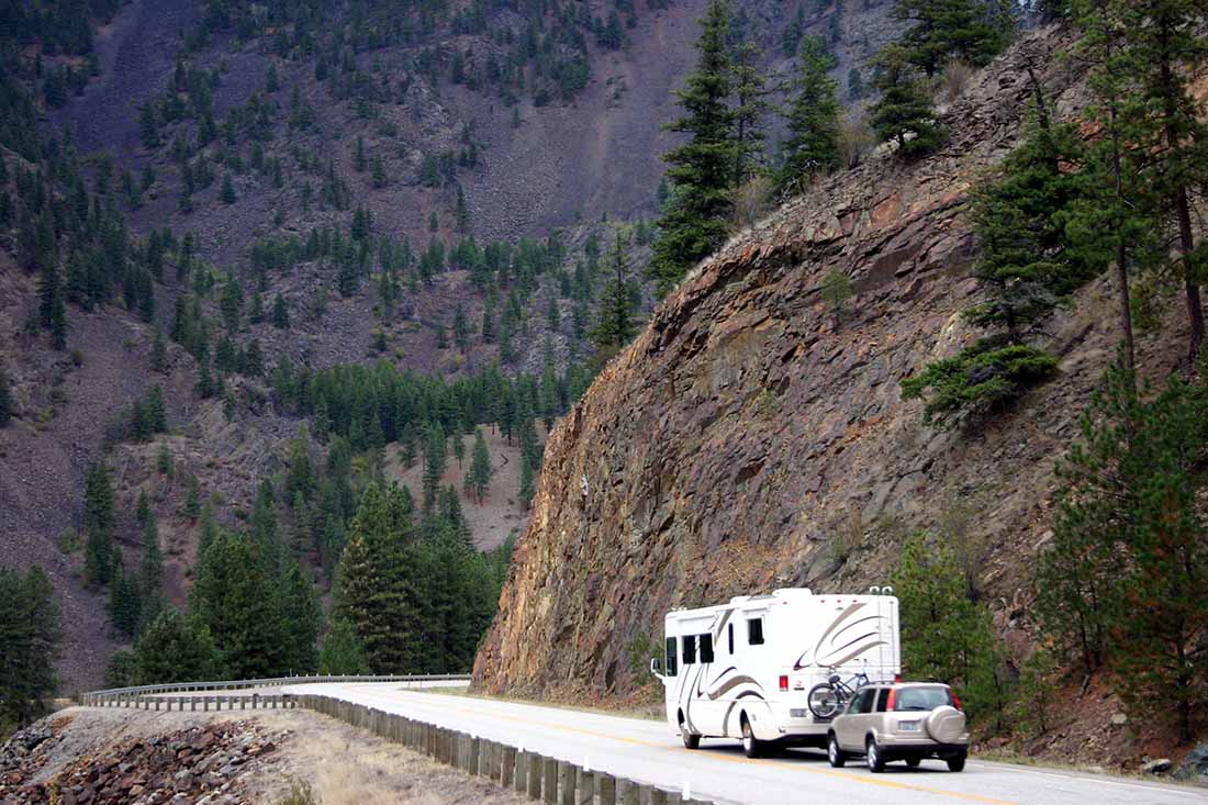 motorhome pulling small suv on a Montana Mountainside