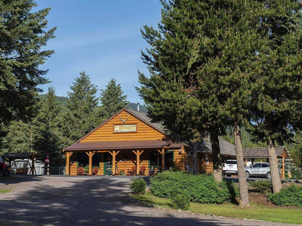 RV park lodge surrounded by robust trees