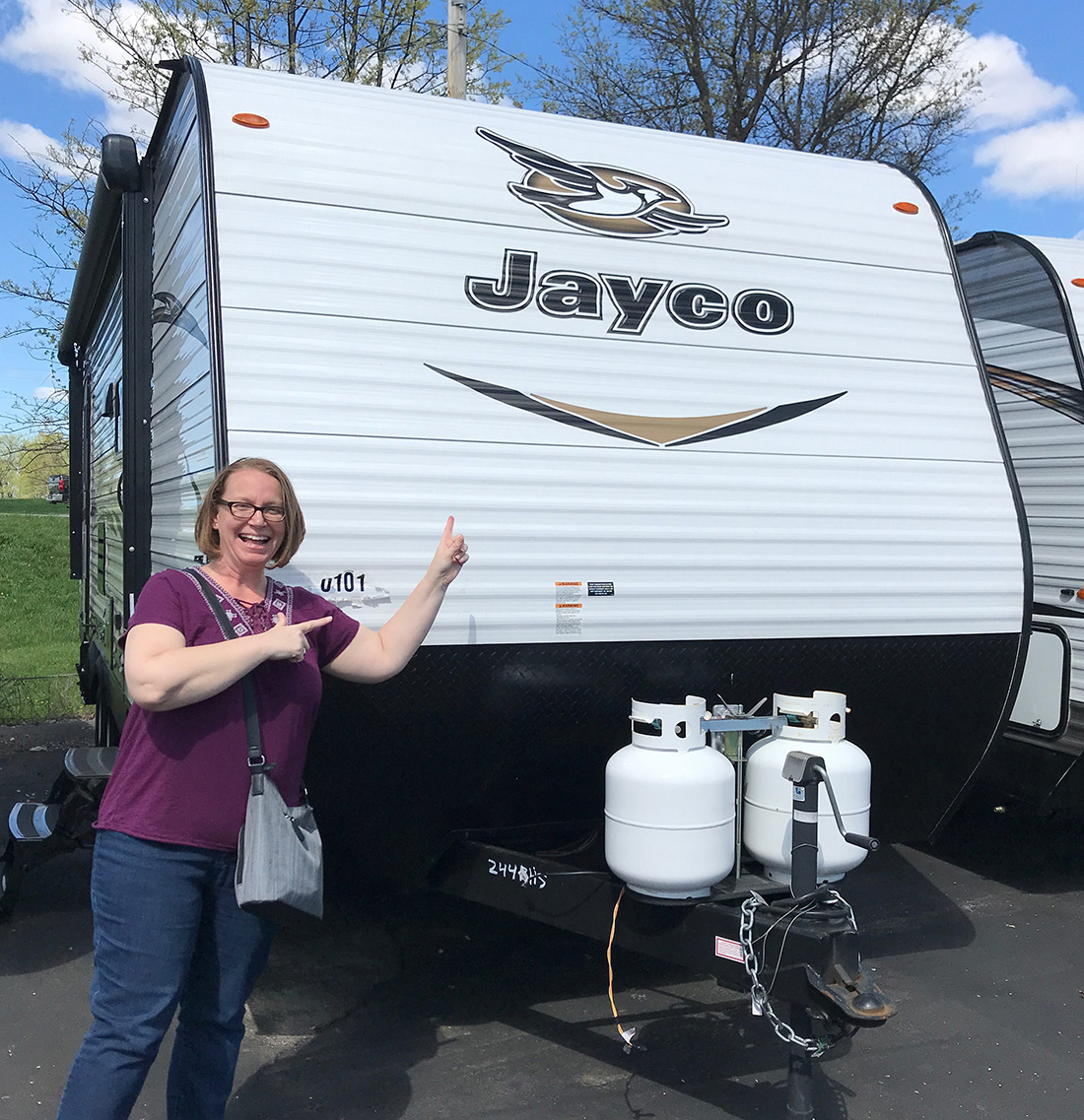 The author in front of the family's new RV.
