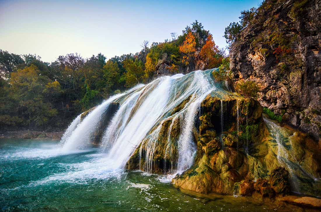 Waterfall in the fall with leaves changing in OK